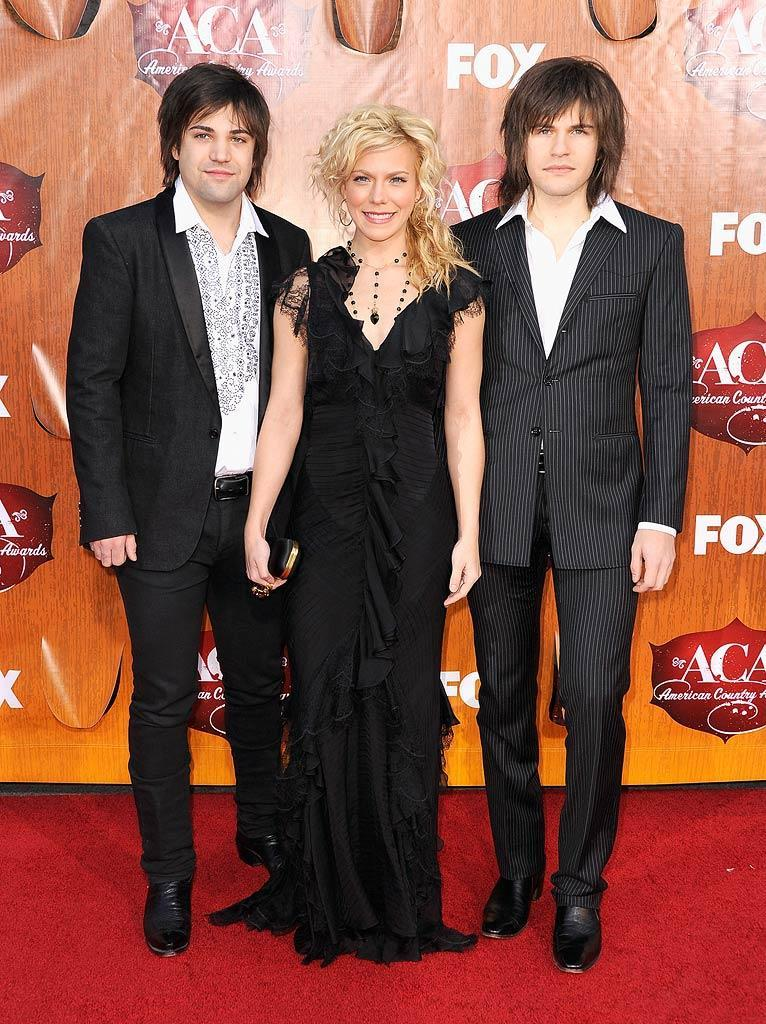 Neil Perry (left), Kimberly Perry, and Reid Perry of The Band Perry arrive at the American Country Awards held at the MGM Grand Garden Arena in Las Vegas. (12/05/2011)