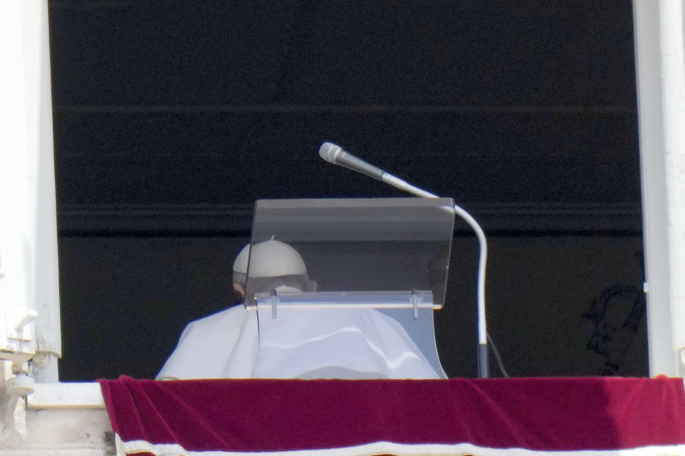 Pope Francis leaves after reciting the Angelus noon prayer from the window of his studio overlooking St.Peter's Square, at the Vatican, Sunday, July 4, 2021. In a brief announcement Sunday afternoon the Vatican said Pope Francis has gone to a Rome hospital for scheduled surgery for a stenosis, or restriction, of the large intestine. (AP Photo/Alessandra Tarantino)
