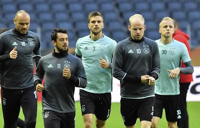 Heiko Westermann, Amin Younes, Joel Veltman, Davy Klaassen and Donny van de Beek run during Ajax's training. (AP Photo)