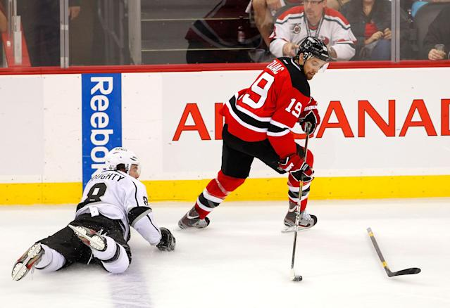 NEWARK, NJ - JUNE 02: Travis Zajac #19 of the New Jersey Devils handles the puck as Drew Doughty #8 of the Los Angeles Kings looks on without his stick during Game Two of the 2012 NHL Stanley Cup Final at the Prudential Center on June 2, 2012 in Newark, New Jersey. (Photo by Paul Bereswill/Getty Images)