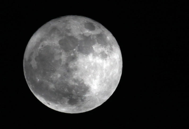 This Saturday, March 19, 2011 photo shows a full moon over Pembroke, N.Y. at its closest point to the Earth since March 1993. The biggest and brightest full moon of the year arrives Saturday night, May 5, 2012 as our celestial neighbor passes closer to Earth than usual. Saturday's event is a ``supermoon,'' the closest and therefore the biggest and brightest full moon of the year. At 11:34 p.m. EDT, the moon will be about 221,802 miles from Earth. That's about 15,300 miles closer than average. (AP Photo/David Duprey)