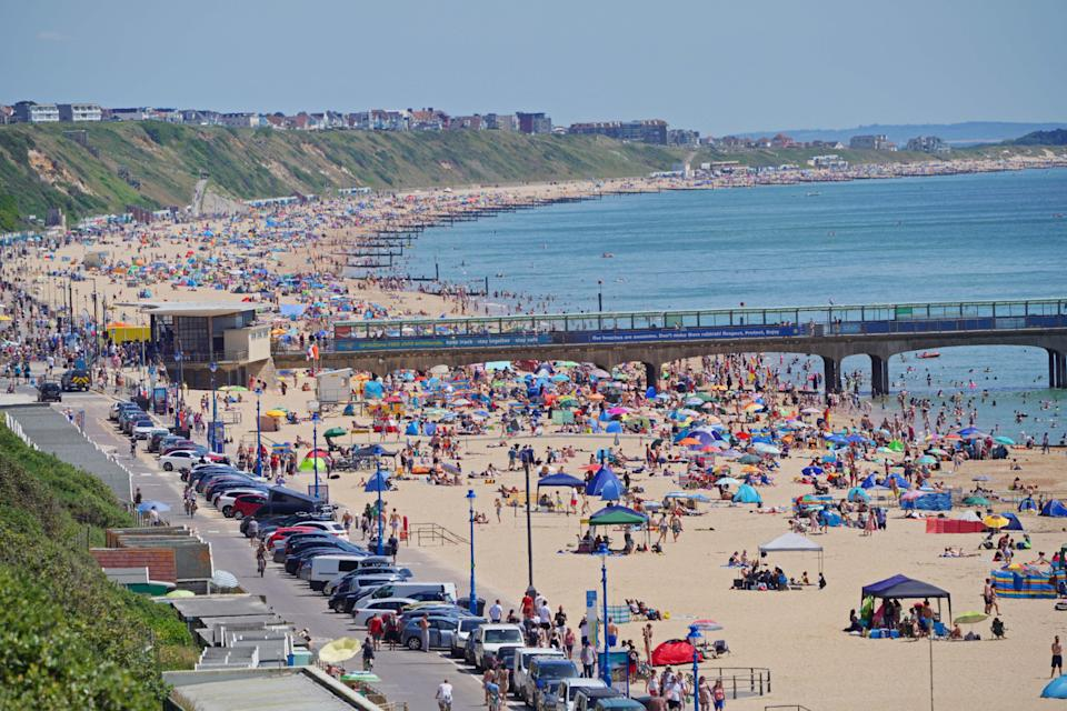 People enjoy the weather on Bournemouth beach in Dorset, (Ben Birchall/PA) (PA Wire)