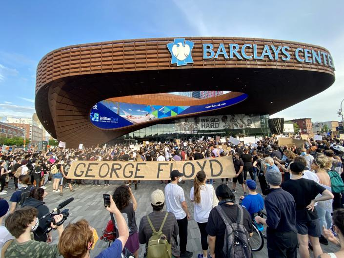 Protesters rally around Barclays Center on May 29. The protest began peacefully but clashes between demonstrators and police escalated to destruction. (Matt Troutman/Patch)