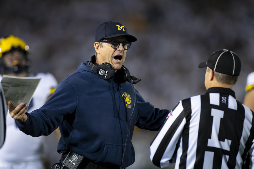 UNIVERSITY PARK, PA - OCTOBER 19:  Head coach Jim Harbaugh of the Michigan Wolverines discusses a previous play with a line judge during the fourth quarter against the Penn State Nittany Lions on October 19, 2019 at Beaver Stadium in University Park, Pennsylvania. Penn State defeats Michigan 28-21.  (Photo by Brett Carlsen/Getty Images)