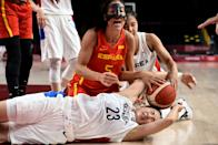 <p>Spain's Cristina Ouvina (C) reacts as she fights for the ball with South Korea's Kim Danbi (bottom) in the women's preliminary round group A basketball match between South Korea and Spain during the Tokyo 2020 Olympic Games at the Saitama Super Arena in Saitama on July 26, 2021. (Photo by Aris MESSINIS / AFP)</p>