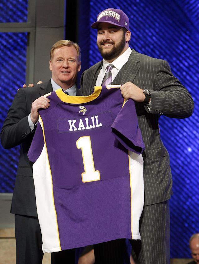 Southern California offensive lineman Matt Kalil, right, poses for photographs with NFL Commissioner Roger Goodell after being selected as the fourth pick overall by the Minnesota Vikings in the first round of the NFL football draft at Radio City Music Hall, Thursday, April 26, 2012, in New York. (AP Photo/Jason DeCrow)