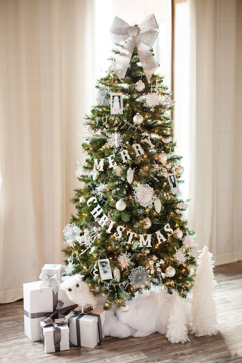 "<p>If you really want your tree to say ""Merry Christmas"" from the moment a guest walks in, don't be afraid to spell it out. A monochromatic tree from <a href=""http://www.thetomkatstudio.com/2013/11/michaelsdreamtreechallenge"" rel=""nofollow noopener"" target=""_blank"" data-ylk=""slk:The Tomkat Studio"" class=""link rapid-noclick-resp"">The Tomkat Studio</a> features a garland casting the season's greetings, which is paired with snowy white ornaments. </p>"