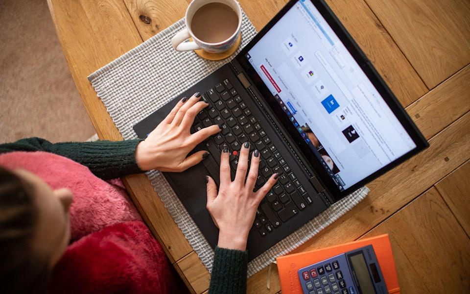 3/3/2020 - a woman using a laptop on a dining room table