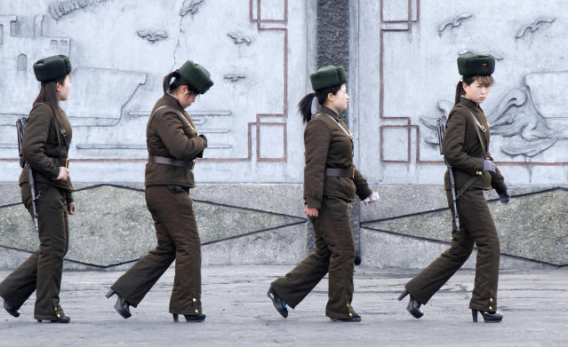 <p>Female North Korean soldiers patrol along the banks of Yalu River, near the North Korean town of Sinuiju, opposite the Chinese border city of Dandong, April 11, 2013. (Jacky Chen/Reuters) </p>