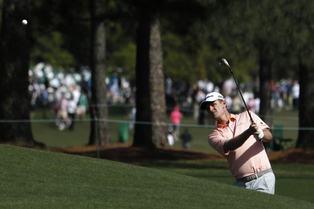 Justin Rose of England chips onto the 8th green during first round play of the 2018 Masters golf tournament at the Augusta National Golf Club in Augusta, Georgia, U.S., April 5, 2018. REUTERS/Jonathan Ernst