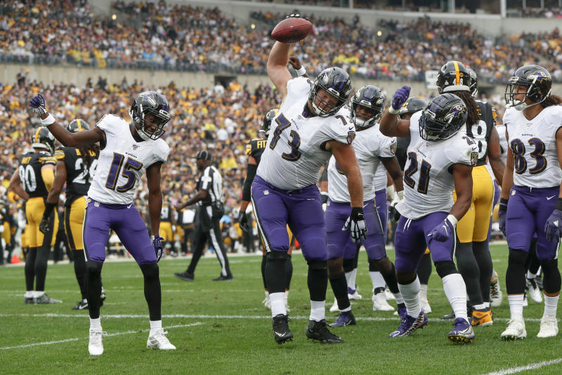 Baltimore Ravens offensive guard Marshal Yanda (73) spikes the football as he celebrates with teammates after running back Mark Ingram (21) scored. (AP Photo/Don Wright)