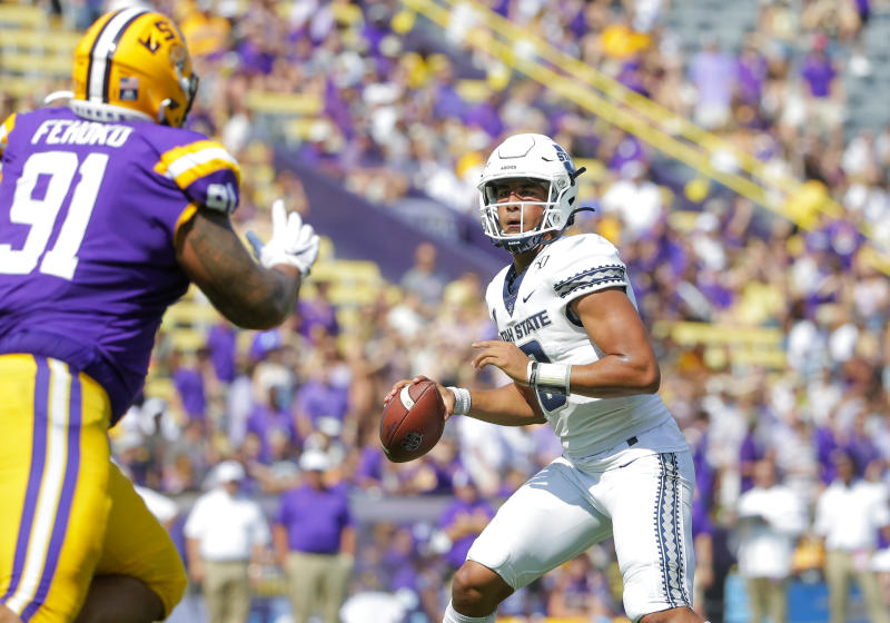 Oct 5, 2019; Baton Rouge, LA, USA; Utah State Aggies quarterback Jordan Love (10) drops back to pass against the LSU Tigers during the first quarter at Tiger Stadium. Mandatory Credit: Derick E. Hingle-USA TODAY Sports