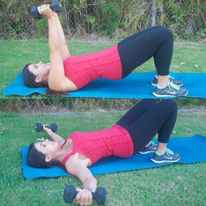 <p><strong>A</strong> Lie faceup with knees bent and feet flat on the floor about 12 inches away from hips. Holding a 10- to 15-pound dumbbell in each hand, extend arms upward, keeping wrists aligned with shoulders and palms facing in. Push into heels and lift glutes and lower back off the mat, keeping core engaged and spine neutral.</p> <p><strong>B</strong> Slowly lower hips to hover just above the mat while opening arms out wide toward the floor in a dumbbell fly. Draw arms back together while lifting hips to return to starting position. Do 12 to 15 reps.</p>