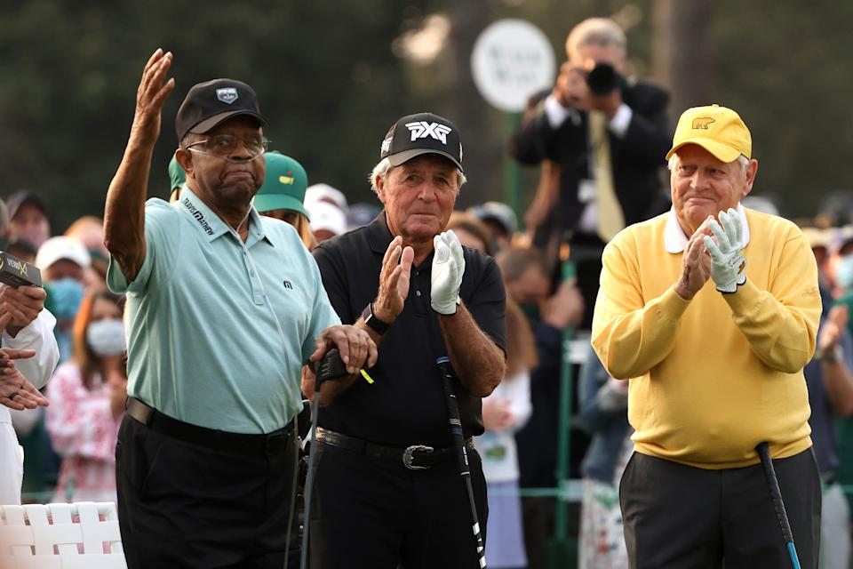 Honorary Starter Lee Elder of the United States (pictured left), waves to the patrons as he is introduced and honorary starter and Masters champion Gary Player (pictured midle) and honorary starter and Masters champion Jack Nicklaus (pictured right) applaud.