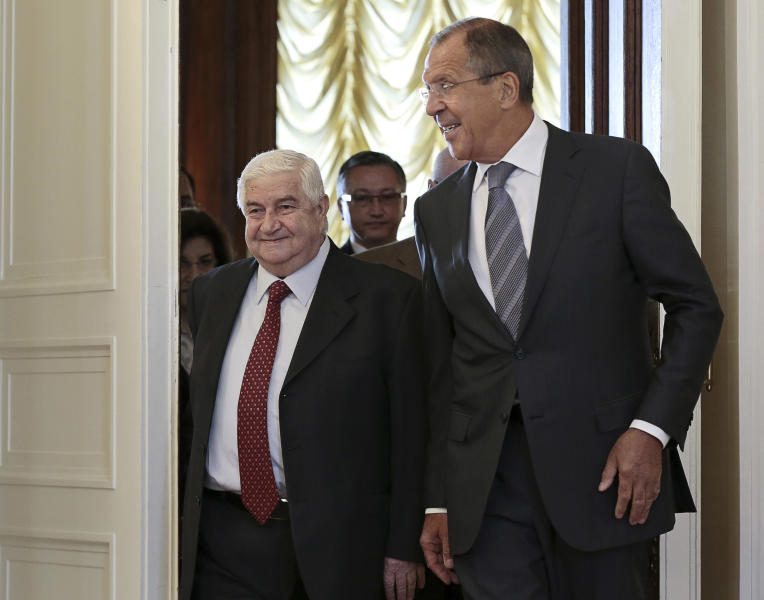 Russian Foreign Minister Sergey Lavrov welcomes his Syrian counterpart Walid al-Moallem, left, prior to talks in Moscow on Monday, Sept. 9, 2013. (AP Photo/Ivan Sekretarev)