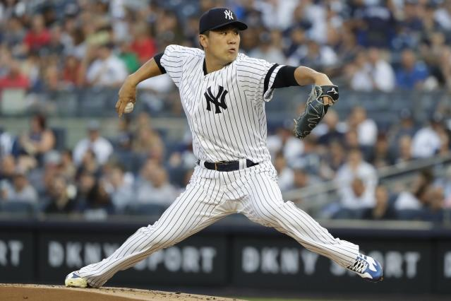 New York Yankees' Masahiro Tanaka, of Japan, delivers a pitch during the first inning of a baseball game against the Cleveland Indians, Friday, Aug. 16, 2019, in New York. (AP Photo/Frank Franklin II)