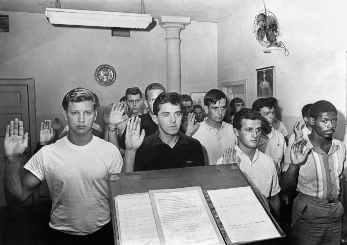 Army inductees pledge their service in New York on July 29, 1965. (Don Hogan Charles/The New York Times)