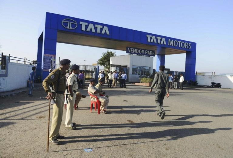 <p>Indian private security guards and police stand guard at the gates amid a protest at the Tata Nano production plant in Sanand Taluka, some 50 kms from Ahmedabad, on February 23, 2017. India police have prevented protesters from demonstrating at the Tata Nano production plant, during a rally by Indian Other Backward Class (OBC) and Ekta Manch political organisation leader Alpesh Thakor and supporters, who accuse big business owners of not employing enough local youths. / AFP PHOTO / SAM PANTHAKY </p>