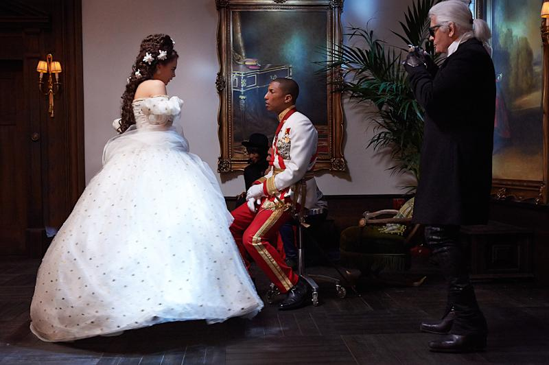 """Cara Delevingne and Pharrell Williams in """"Reincarnation,"""" the short film shot by Karl Lagerfeld for Chanel."""