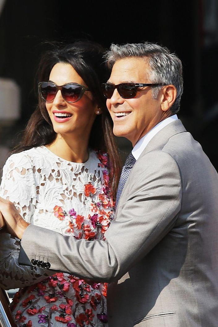 """<p>Amal's fears of becoming a <a class=""""link rapid-noclick-resp"""" href=""""https://www.womenshealthmag.com/relationships/a21234538/amal-clooney-george-clooney-speech-afi/"""" rel=""""nofollow noopener"""" target=""""_blank"""" data-ylk=""""slk:""""spinster"""""""">""""spinster""""</a> didn't come true when George proposed over a candlelit, champagne dinner after six months of dating in 2014. They were married in September 2014 in Venice, Italy, <a class=""""link rapid-noclick-resp"""" href=""""https://www.townandcountrymag.com/style/a20241776/george-clooney-amal-clooney-love-marriage-story/"""" rel=""""nofollow noopener"""" target=""""_blank"""" data-ylk=""""slk:Town & Country""""><em>Town & Country</em></a> details; the couple welcomed twins together, Ella and Alexander, in 2017. Their status? Still going strong.</p>"""