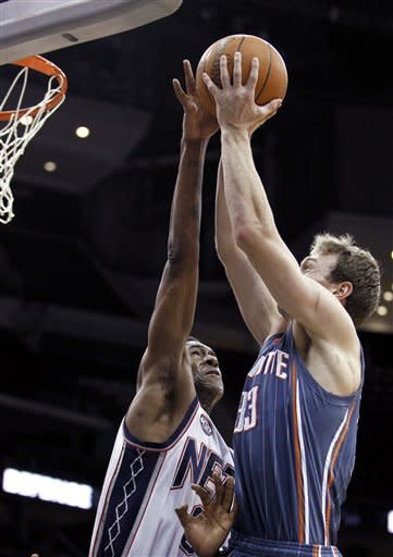Charlotte Bobcats' Matt Carroll, right, goes up for a shot against New Jersey Nets' MarShon Brooks during the fourth quarter of an NBA basketball game, Sunday, Jan. 22, 2012, in Newark, N.J. The Nets won 97-87. (AP Photo/Julio Cortez)