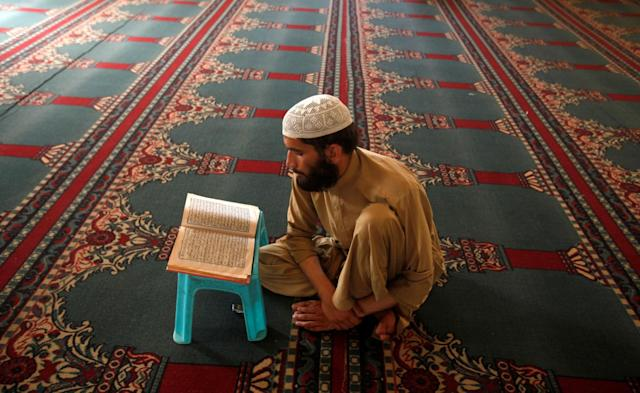 <p>A Muslim man prays as he prepares to break the fast on the first day of the holy month of Ramadan in Peshawar, Pakistan, May 27, 2017. (Fayaz Aziz/Reuters) </p>