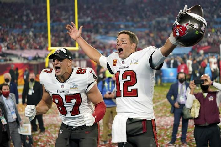 Tampa Bay Buccaneers tight end Rob Gronkowski (87), left, and Tampa Bay Buccaneers quarterback Tom Brady (12) celebrate together after the NFL Super Bowl 55 football game against the Kansas City Chiefs, Sunday, Feb. 7, 2021, in Tampa, Fla. The Tampa Bay Buccaneers defeated the Kansas City Chiefs 31-9. (AP Photo/Steve Luciano)