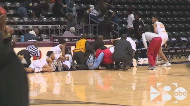 PHOTO: In this still from a video, people react after a shooting broke out at a high school basketball game in Dallas over the weekend. (WFAA)