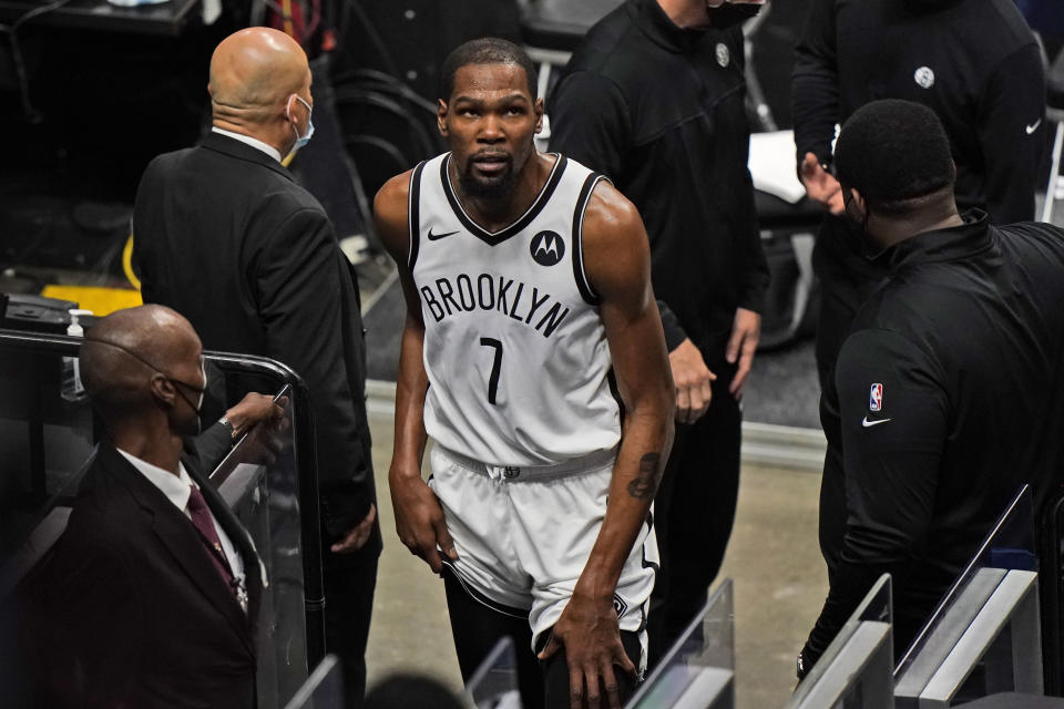 Brooklyn Nets forward Kevin Durant (7) leaves the court after a play during the first half of an NBA basketball game against the Miami Heat, Sunday, April 18, 2021, in Miami. (AP Photo/Wilfredo Lee)