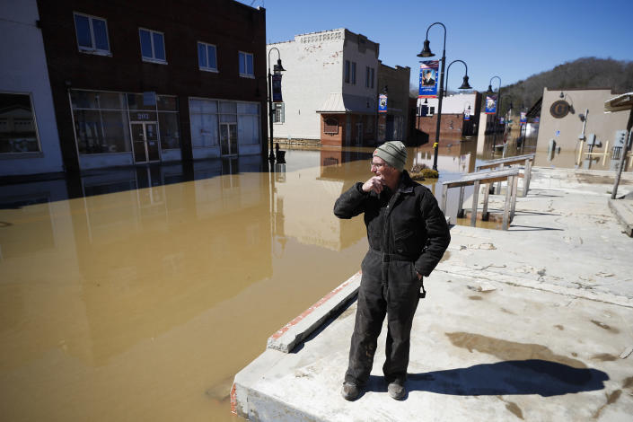 Phillip Lucas, of Beattyville, Ky., overlooks a flooded Main Street after heavy rains caused the Kentucky River to flood most of downtown Beattyville, Ky., Tuesday, March 2, 2021. Lucas owns a building along Main Street and was preparing to assess the damage. (Alex Slitz/Lexington Herald-Leader via AP)