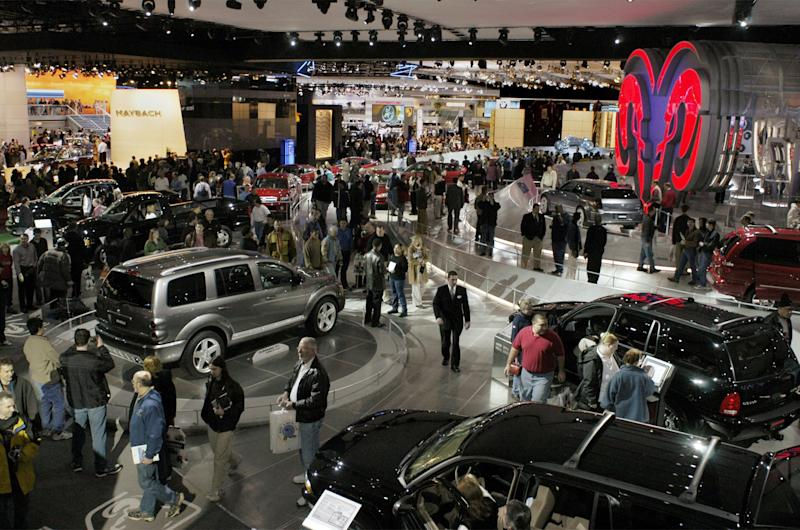 FILE - In this Saturday, Jan. 11, 2003, file photo, visitors at the North American International Auto Show walk the floor at Cobo Hall in Detroit. Hundreds of thousands of buyers and car fans are expected to crowd Detroit's North American International Auto Show from Jan. 14-27, 2013. Some 800,000 visitors are expected to descend on the city's 18-acre Cobo Center, where more than 500 cars and trucks will be on display. (AP Photo/Paul Warner, File)