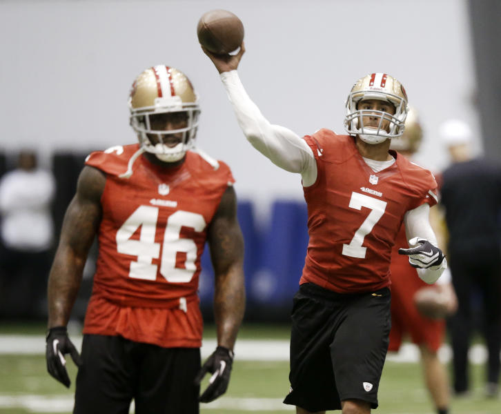 San Francisco 49ers quarterback Colin Kaepernick (7) passes as tight end Delanie Walker (46) waits to run a route during practice on Wednesday, Jan. 30, 2013, in New Orleans. The 49ers are scheduled to play the Baltimore Ravens in the NFL Super Bowl XLVII football game on Feb. 3. (AP Photo/Mark Humphrey)