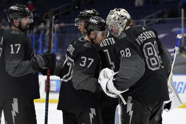 Tampa Bay Lightning goaltender Andrei Vasilevskiy (88) celebrates with center Yanni Gourde (37) and left wing Alex Killorn (17) after an NHL hockey game against the Chicago Blackhawks Saturday, March 20, 2021, in Tampa, Fla. (AP Photo/Chris O'Meara)