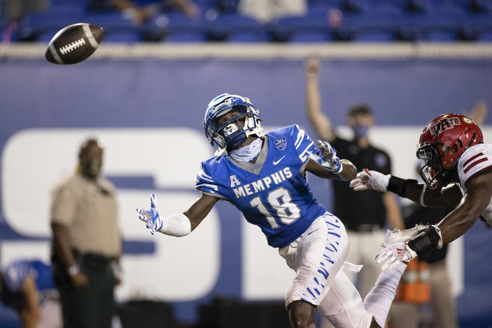 MEMPHIS, TN - SEPTEMBER 05:  Tahj Washington #18 of the Memphis Tigers watches a pass fall incomplete during the fourth quarter against the Arkansas State Red Wolves at Liberty Bowl Memorial Stadium on September 5, 2020 in Memphis, Tennessee. Memphis defeated Arkansas State 37-24. (Photo by Brett Carlsen/Getty Images)