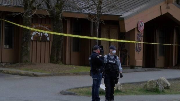 RCMP at the scene in Port Alberni, B.C., where a 20-year-old man was found dead from stab wounds in the chest. (CHEK News - image credit)