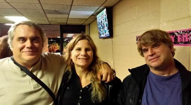 Paul Michels, right, shown with his sister, Sarah, and brother, John, left, in Michigan in October 2015, was among eight people killed this week in the shootings at three Georgia massage parlors in the Atlanta area.