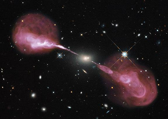A supermassive black hole powers jets of cosmic rays on either side the elliptical radio galaxy Hercules A.