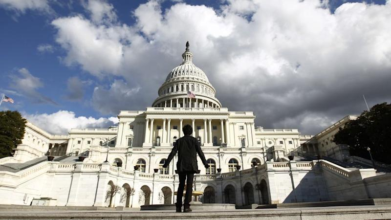 A tourist gazes up at the Capitol in Washington