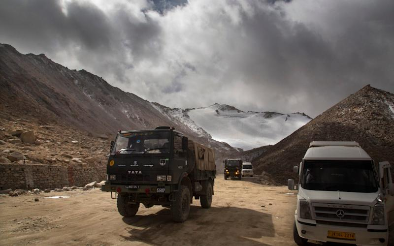 An Indian Army truck crosses Chang la pass near Pangong Lake in Ladakh region, India. Indian and Chinese soldiers are in a bitter standoff - AP