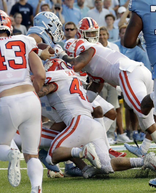 North Carolina's Sam Howell (7) gets stopped on a two-point conversion by Clemson's James Skalski (47) and Xavier Thomas (3) in the fourth quarter of an NCAA college football game in Chapel Hill, N.C., Saturday, Sept. 28, 2019. (AP Photo/Chris Seward)
