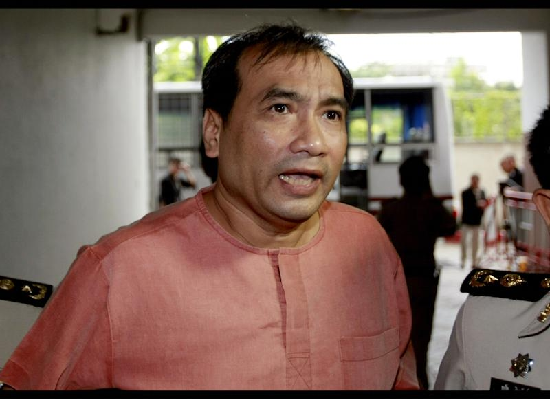 FILE - In this Oct. 10, 2011 file photo, Joe Gordon, a Thai-born American, speaks to reporters upon his arrival at criminal court in Bangkok, Thailand. Gordon sentenced to two and a half years in Thai prison for translating a banned biography about the country's king and posting the content online has been freed by a royal pardon, the U.S. Embassy said Wednesday, July 11, 2012. (AP Photo/Apichart Weerawong, File)