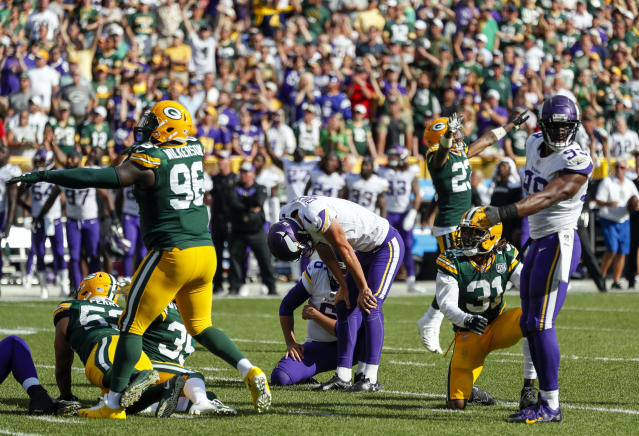 FILE - In this Sunday, Sept. 16, 2018, file photo, Minnesota Vikings kicker Daniel Carlson reacts after missing a field goal during overtime in an NFL football game against the Green Bay Packers in Green Bay, Wis. The game finished 29-29. The NFL reduced the length of overtime from 15 minutes to 10 before last season. (AP Photo/Matt Ludtke, File