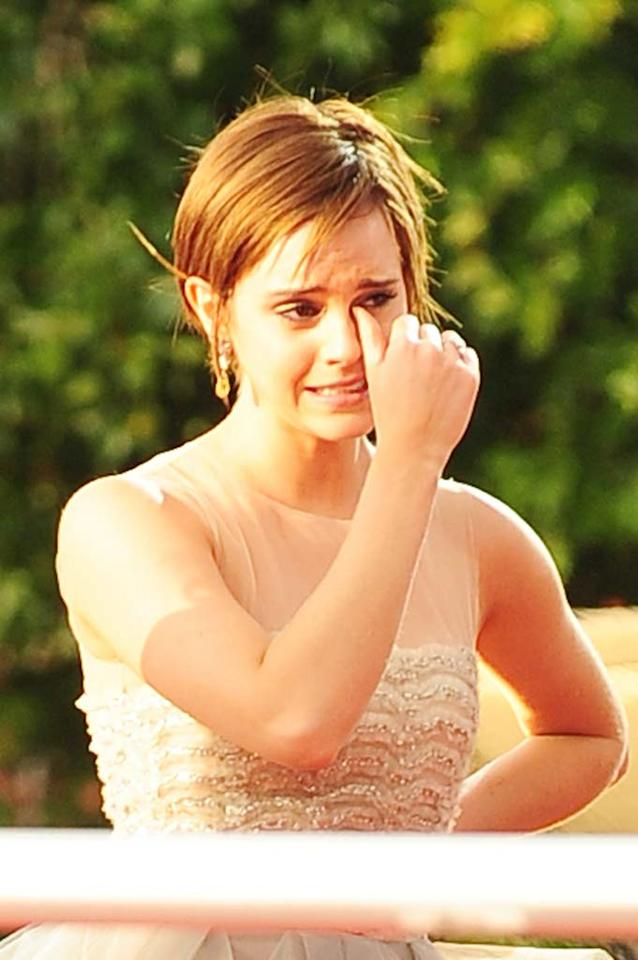 """Emma Watson is caught in a downward spiral of partying because she's so distraught over the end of the 'Harry Potter' franchise,"" reports <i>Star</i>. According to the mag, ""Emma was out of control"" at the film's premiere after-party, ""dancing rowdily one minute and then sobbing on a crew member's shoulder the next."" For how far gone Watson is, and when her family plans to have an intervention, check out what an insider confides to <a href=""http://www.gossipcop.com/emma-watson-partying-meltdown-harry-potter-end-over-done/"" target=""new"">Gossip Cop</a>. <a href=""http://www.pacificcoastnews.com/"" target=""new"">PacificCoastNews.com</a> July 7, 2011"