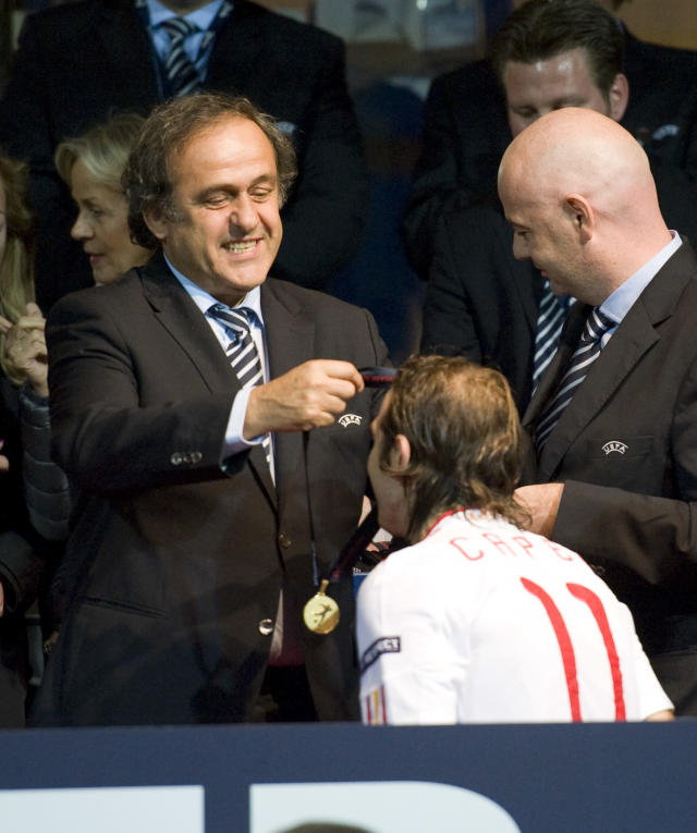 UEFA President Michel Platini (L) hands over a medal to Diego Capel of Spain after Spain won the European Under-21 Championship final football match between Switzerland and Spain at NRGI Park Stadium in Arhus Stadion Denmark on June 25, 2011. AFP PHOTO/JONATHAN NACKSTRAND (Photo credit should read JONATHAN NACKSTRAND/AFP/Getty Images)
