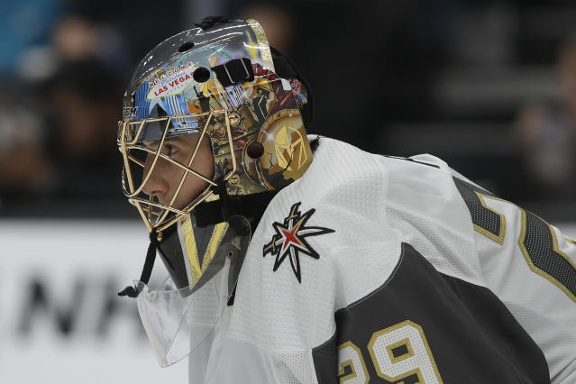 Vegas Golden Knights goaltender Marc-Andre Fleury watches action while defending his net during the first period of an NHL preseason hockey game against the San Jose Sharks in San Jose, Calif., Saturday, Sept. 21, 2019. (AP Photo/Jeff Chiu)