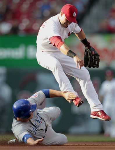 Chicago Cubs' Bryan LaHair, left, is out at second as St. Louis Cardinals second baseman Skip Schumaker turns the double play during the second inning of a baseball game Monday, May 14, 2012, in St. Louis. The Cubs' Alfonso Soriano was out at first. (AP Photo/Jeff Roberson)