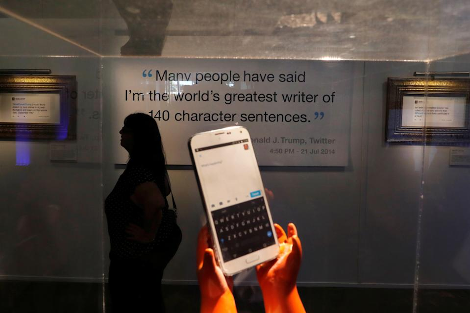 """A local resident attends the opening of the """"Donald J. Trump Presidential Twitter Library,"""" a comedic installation showcasing U.S. President Donald Trump's Twitter history in downtown Washington D.C., U.S. June 14, 2019. REUTERS/Carlos Barria"""