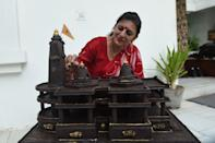 Shilpa Bhatt, 40, an entrepreneur and manufacturer-supplier of chocolates gives finishing touches to the model of Ram temple of Ayodhya on the outskirts of Ahmedabad on August 4, 2020. - Shilpa made the Ram Temple of Ayodhya chocolate model using some 15 kg chocolates in some 12 hours. (Photo by SAM PANTHAKY / AFP) (Photo by SAM PANTHAKY/AFP via Getty Images)