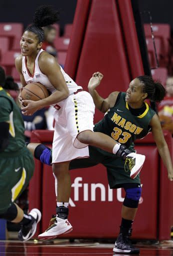 Maryland forward Alyssa Thomas, left, grabs a rebound over George Mason forward Joyous Tharrington in the second half of an NCAA college basketball game in College Park, Md., Saturday, Dec. 8, 2012. Thomas earned a triple-double in Maryland's 90-40 win. (AP Photo/Patrick Semansky)