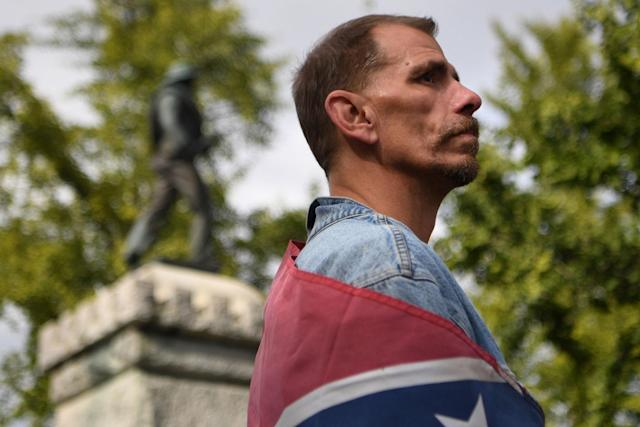 """<p>""""White Lives Matters"""" protester Keith Fuller stands below a Confederate Soldier monument while looking across at counter protesters during a rally in Murfreesboro, Tenn., Oct. 28, 2017. (Photo: Bryan Woolston/Reuters) </p>"""